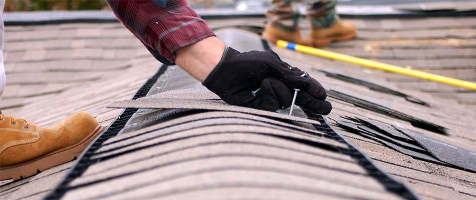 Roof repair being fixed by contractor that offers Camarillo commercial roofing.