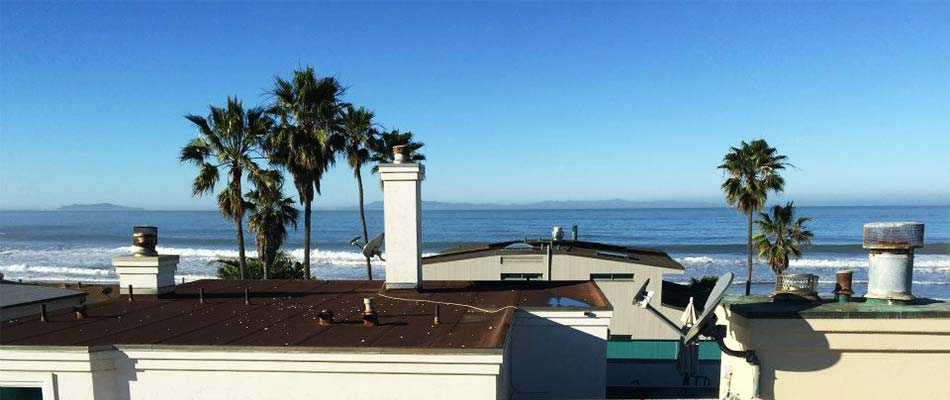 Beach house roof installed by roofing contractors in Ventura, CA.